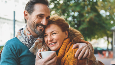 middle aged couple enjoying coffee
