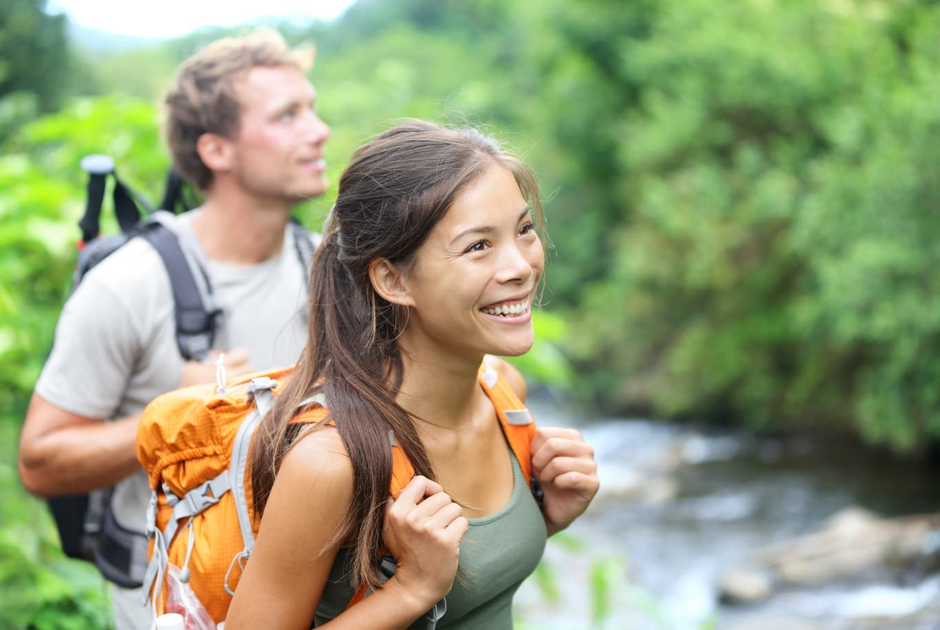 young couple hiking outdoors